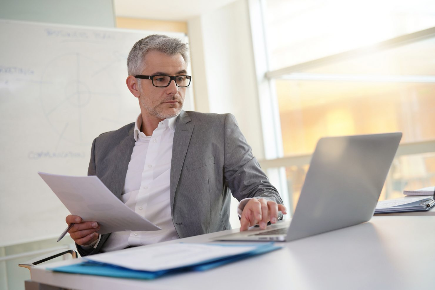 Businessman in office working on laptop