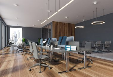 Modern office open concept with grey walls hardwood floors